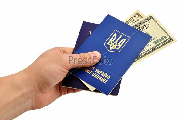 Фотография на тему Украинский заграничный паспорт и доллары в руке