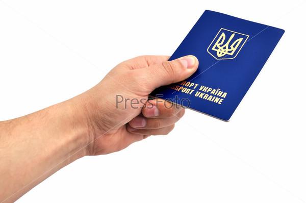 Украинский заграничный паспорт в руке