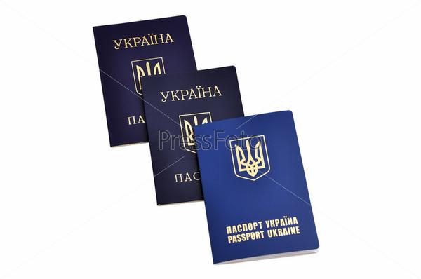 Фотография на тему Паспорта гражданина Украины и украинский заграничный паспорт на белом фоне