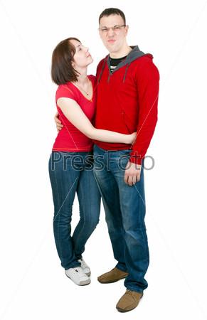 Красивая пара в студии на белом фоне