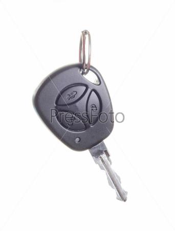 Ключ от автомобиля на белом фоне