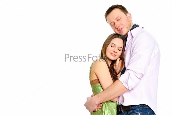 Портрет обнимающейся влюбленной пары. Подарки на переднем плане