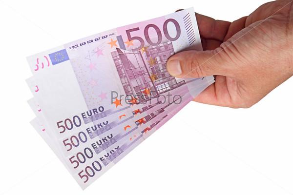 Банкноты евро в руке на белом фоне