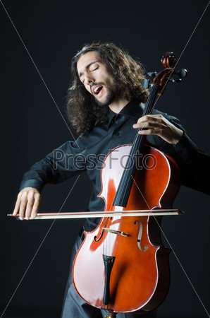 Фотография на тему Молодой человек играет на виолончели