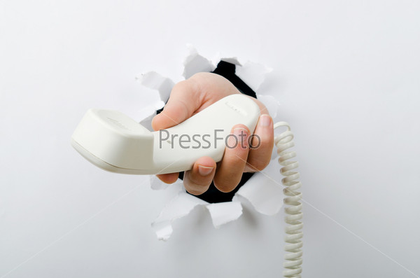 Фотография на тему Рука телефонной трубкой через отверстие в бумаге