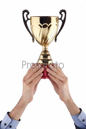 Кубок в руках победителя на белом фоне