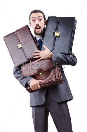 Предприниматель с портфелями на белом фоне
