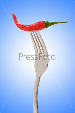 Красный перец на вилке