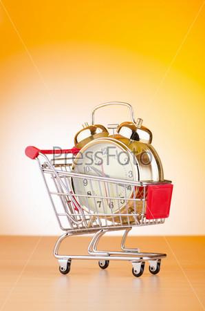 Фотография на тему Будильник в корзине для покупок