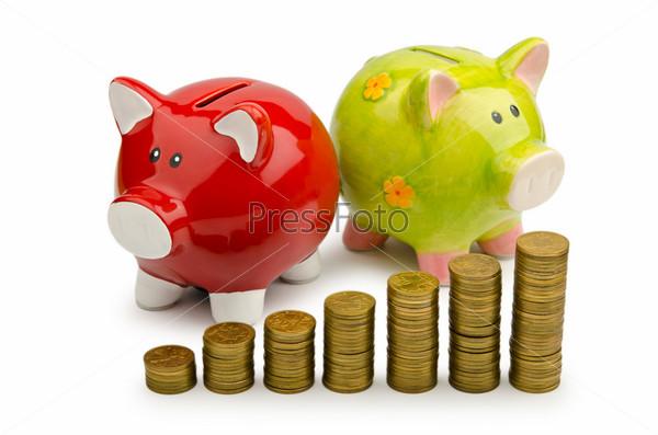 Фотография на тему Копилки с монетами на белом фоне