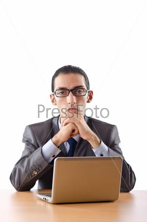 Фотография на тему Бизнесмен с ноутбуком за столом