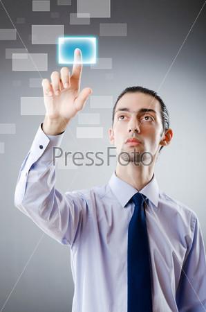Фотография на тему Бизнесмен нажимает пальцем на виртуальную кнопку