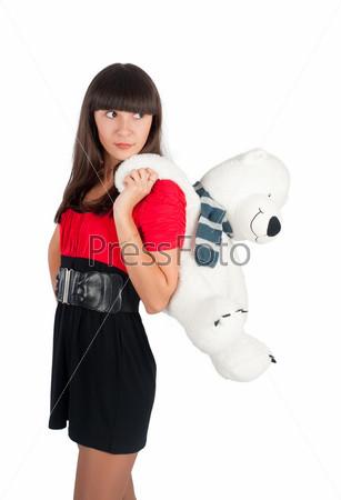 Красивая девушка с игрушечным медведем
