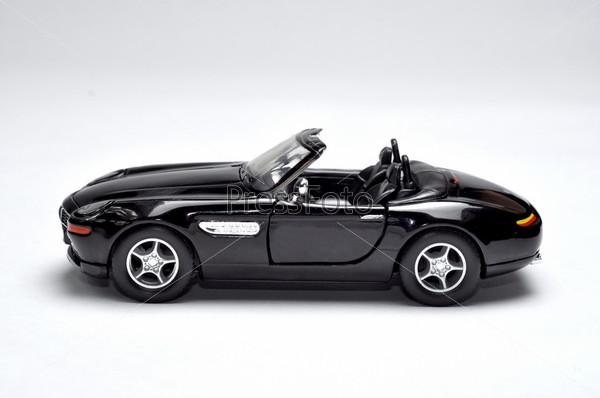 Фотография на тему Спортивный автомобиль черного цвета на светлом фоне
