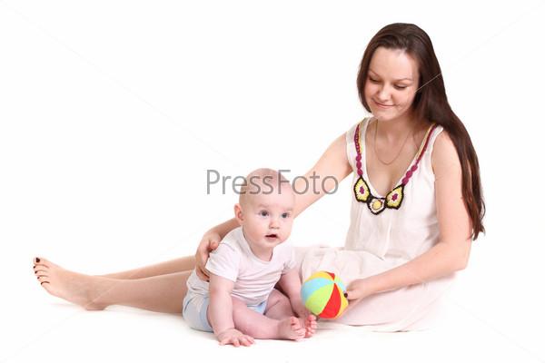 Фотография на тему Молодая мама играет с сыном на белом фоне