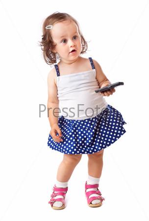 Фотография на тему Маленькая девочка с мобильным телефоном, изолированная на белом фоне
