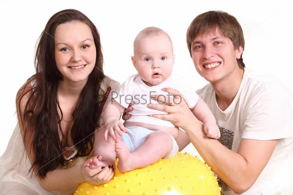 Фотография на тему Портрет молодой семьи на белом фоне. Папа, мама и малыш