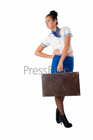 Фотография на тему Привлекательная молодая стюардесса со старым чемоданом, изолированная на белом фоне