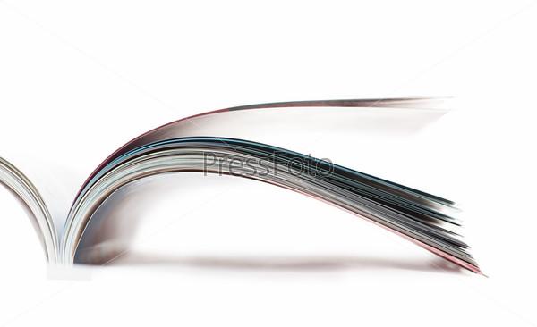Открытый журнал на белом фоне