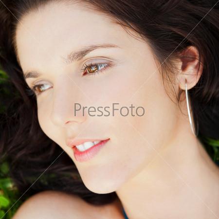 Pretty brunette woman wearing elegant dress relaxing outdoor in