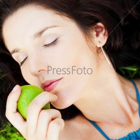Pretty brunette girl wearing elegant dress relaxing outdoor in g