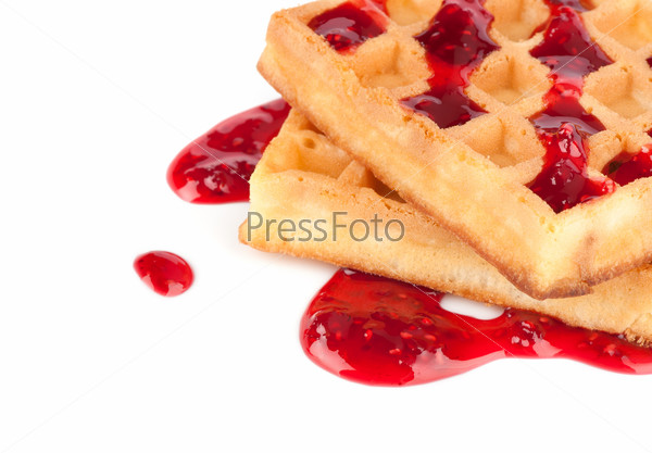 Sweet waffles with strawberry jam isolated on white