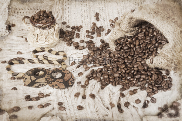 ceramic cup of coffee, roasted coffee beans and wooden bijouteri