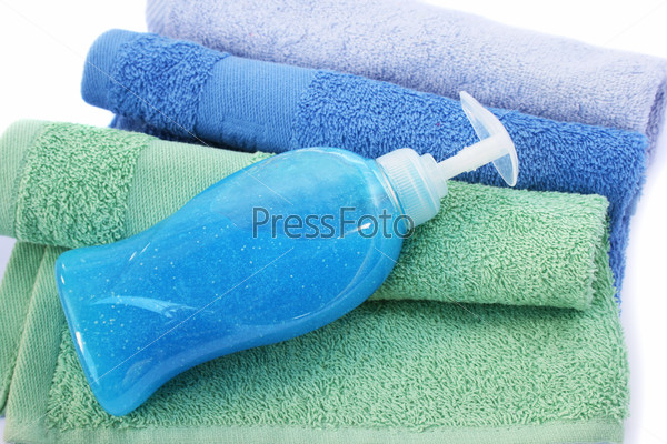 Towels and liquid soap bottle