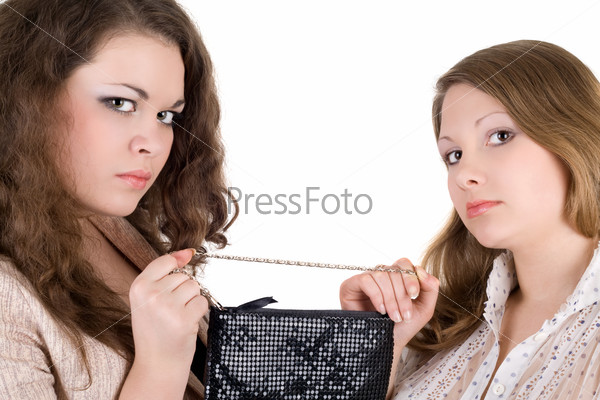 Quarrel of two beautiful girls because of a handbag