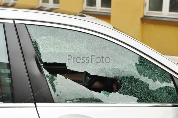 Broken passenger window, car theft