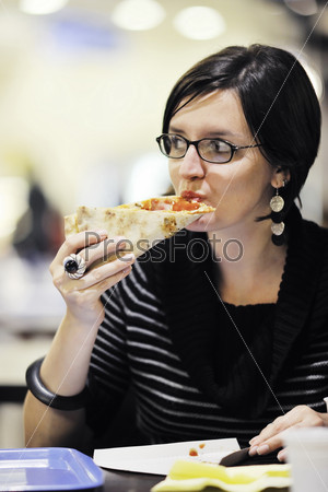 woman eat pizza food at restaurant