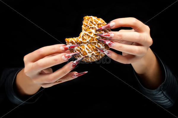 Woman's hand with bitten cookie