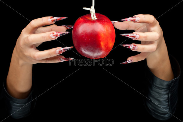 Woman's hand with apple