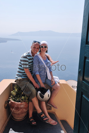 happy young couple tourists in greece