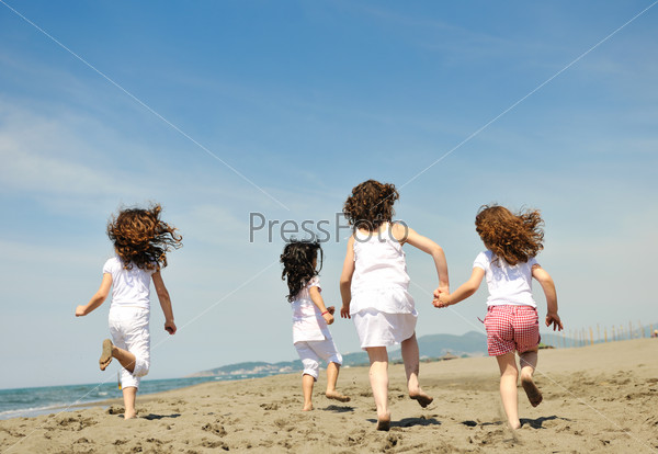 happy child group playing  on beach
