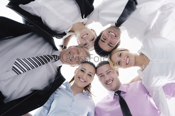 business people with their heads together