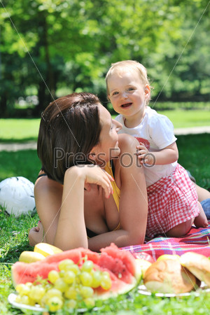 woman and baby playing at park