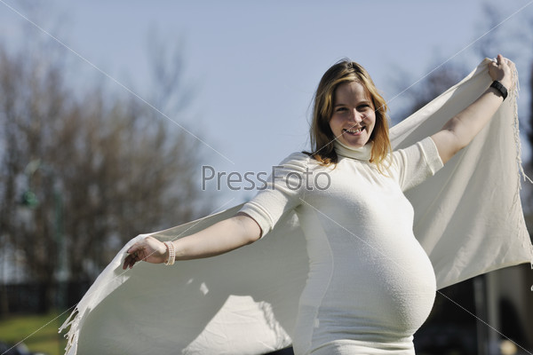 happy young pregnant woman outdoor