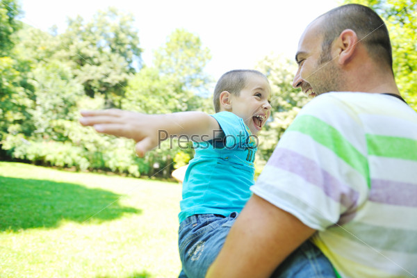 happy father and son have fun at park