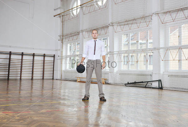 businessman holding basketball ball