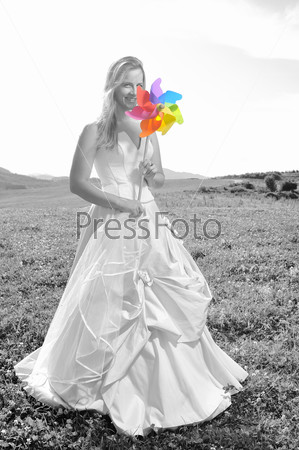 beautiful bride outdoor with colorful windmill toy