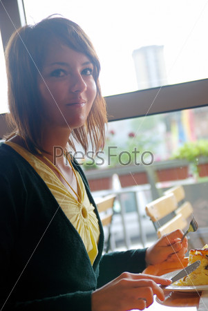 woman eating at an restaurant