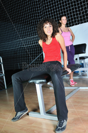 two women work out   in fitness club
