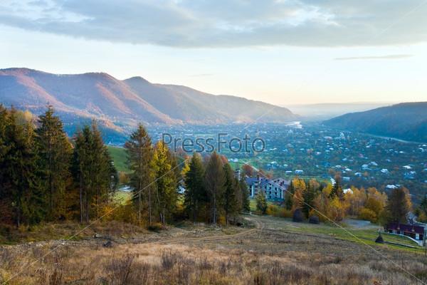 Autumn mountain village and sunrise