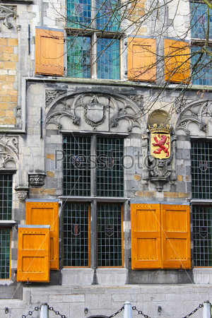 The facade of a historic building in the center of Delft. Nether