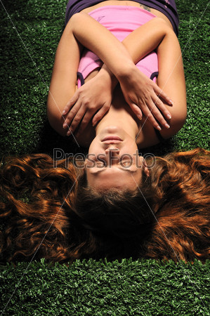 young woman relax on green stairs with grass surface