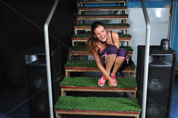 young woman smiling on green stairs