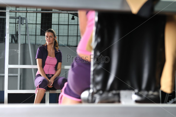 young woman relaxing from working out in a gym