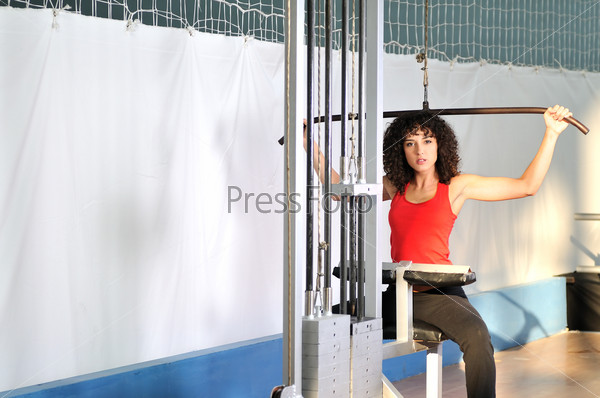 young woman practicing fitness