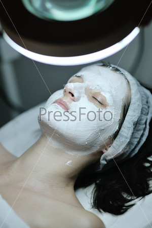 woman with facial mask in cosmetic studio